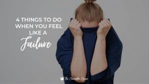 Image reads 4 things to do when you feel like a failure. Shows a woman hiding her face in her shirt.