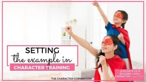 supermom with daughter in superhero pose tex reads Setting the Example In Character Training